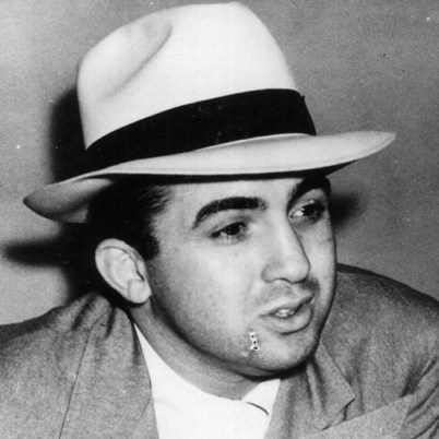 "Michael ""Mickey"" Cohen was born September 4, 1913 in Brownsville, New York. Cohen first came into contact with the mafia world in Chicago when he met Al Capone. In 1947, ""Bugsy"" Siegal was assassinated and Cohen became a west coast mafia boss. In addition to traditional mafia business, Cohen took advantage of the movie business, at one time blackmailing Lana Turner."