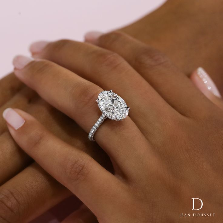 Chelsea, a platinum diamond engagement ring set with a 5 carat oval cut diamond, exclusively designed and handcrafted by Jean Dousset.