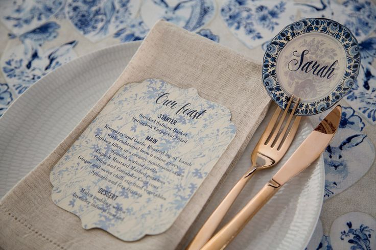 Blue and white delft wedding table setting with scalloped edge menu and round place-card. Styling by Jani Venter. Photo by Rikki Hibbert. Flowers by Diamonds & Pearls Event Styling.