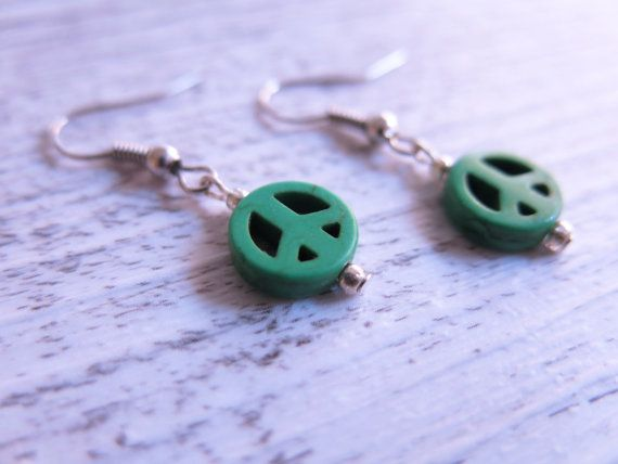 These beautiful earrings feature 1cm green howlite stones carved into peace signs hanging from a silver plated hook earrings.  Howlite is a