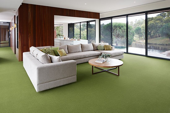 True Australian style is a classic mix of colour inspired by the surrounding landscape. Gum leaf green wool plush pile carpet harmonises with warm timber architectural features, reflecting nature's palette.  Credits - Carpet: Godfrey Hirst Carpets; table & vessels on bench: Mark Tuckey; Cushions: Linen House & Aura Home