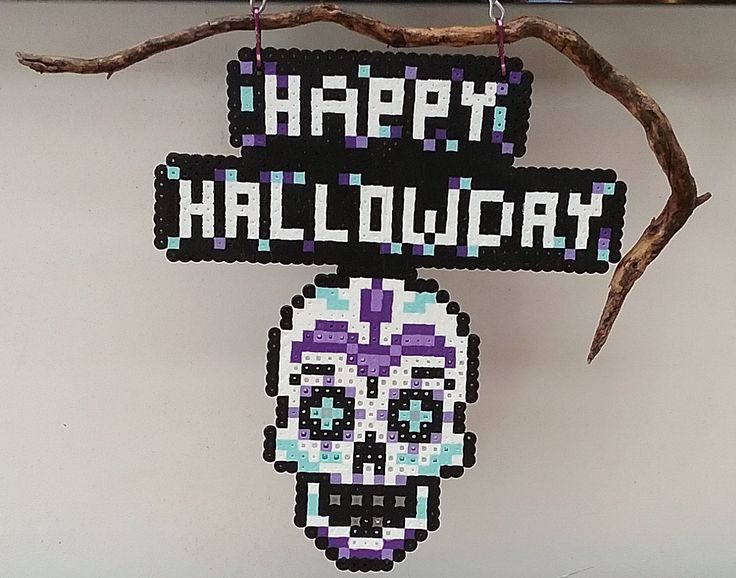 Happy Hallowday with Shull, made with perler beads on a piece of drift wood.