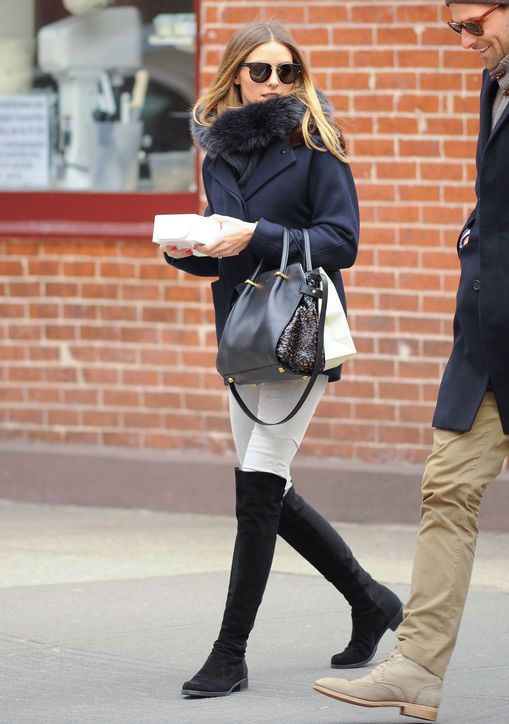 """Olivia Palermo  Over-the-knee boots Palermo's a big fan of the statement shoes with or without heels, calling them super versatile, and is quick to suggest ways to style them for work and play. """"Wear them over a pair of skinnies with your favorite sweater for a low-key weekday look or under a tulip hem skirt and a silk blouse for work,"""" she suggested."""