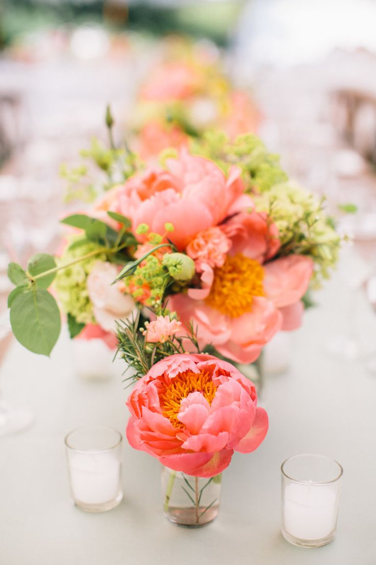 Coral Charm Peony posies scattered about - mmmm love. See more on #SMP here - http://www.StyleMePretty.com/2014/05/09/marion-summer-waterfront-wedding/ Joyelle West Photography - jwestwedding.com
