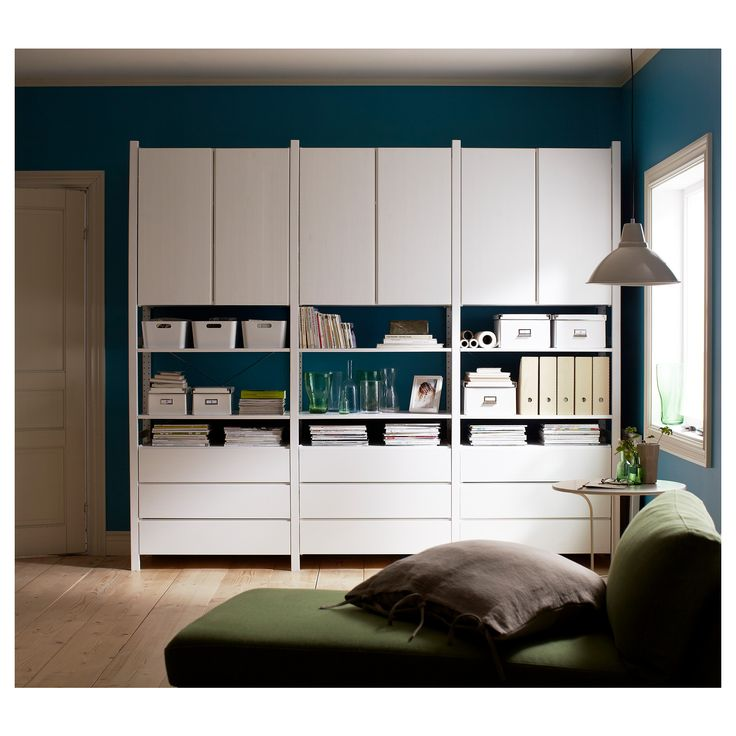 Ikea Ivar cabinets and drawers painted white and arranged into a stylish storage unit.