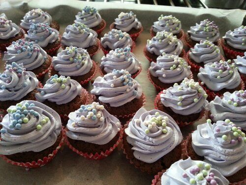 Chocolate cupcakes with pale lilac creamcheesefrosting