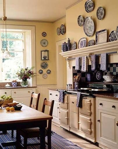 Light-filled kitchen with warm butter-yellow walls & vintage blue transferware.