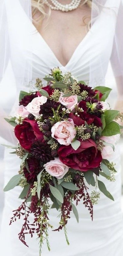 I love the deep red roses with the soft pink ones. A stunning wedding bouquet.