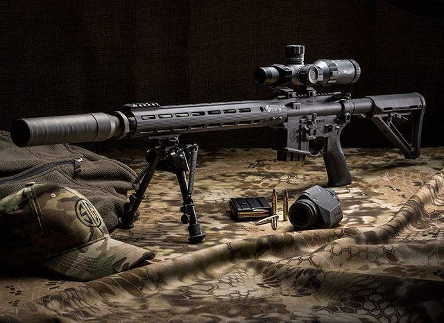 SIGM400 Predator in 300BLK with WHISKEY5 1-5x20 riflescope, SRD762TI-QD suppressor, OSCAR3 6-12x25 spotting scope, SIG SAUER Elite Match Grade 300BLK 125 grain supersonic ammo, the SIG SAUER Camo Hat, and the SIG SAUER Quarter Zip Pullover. #thecompletesy