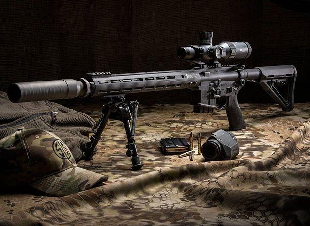 SIGM400 Predator in 300BLK with WHISKEY5 1-5x20 riflescope, SRD762TI-QD suppressor, OSCAR3 6-12x25 spotting scope, SIG SAUER Elite Match Grade 300BLK 125 grain supersonic ammo, the SIG SAUER Camo Hat, and the SIG SAUER Quarter Zip Pullover. #thecompletesy