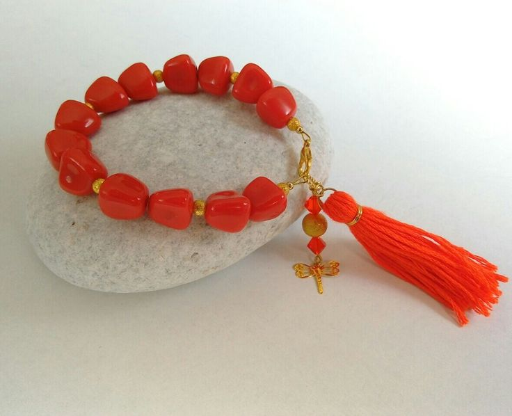Bracelet with coral beads and tassel. https://m.facebook.com/ElitasBijoux?ref=hl&__nodl