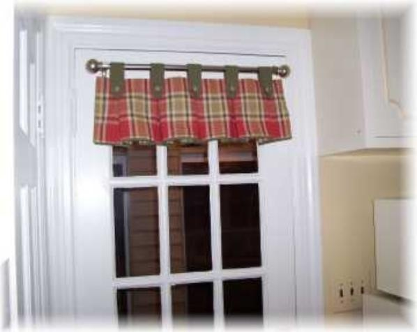Curtain Panels With Tabs For A Small Kitchen Window