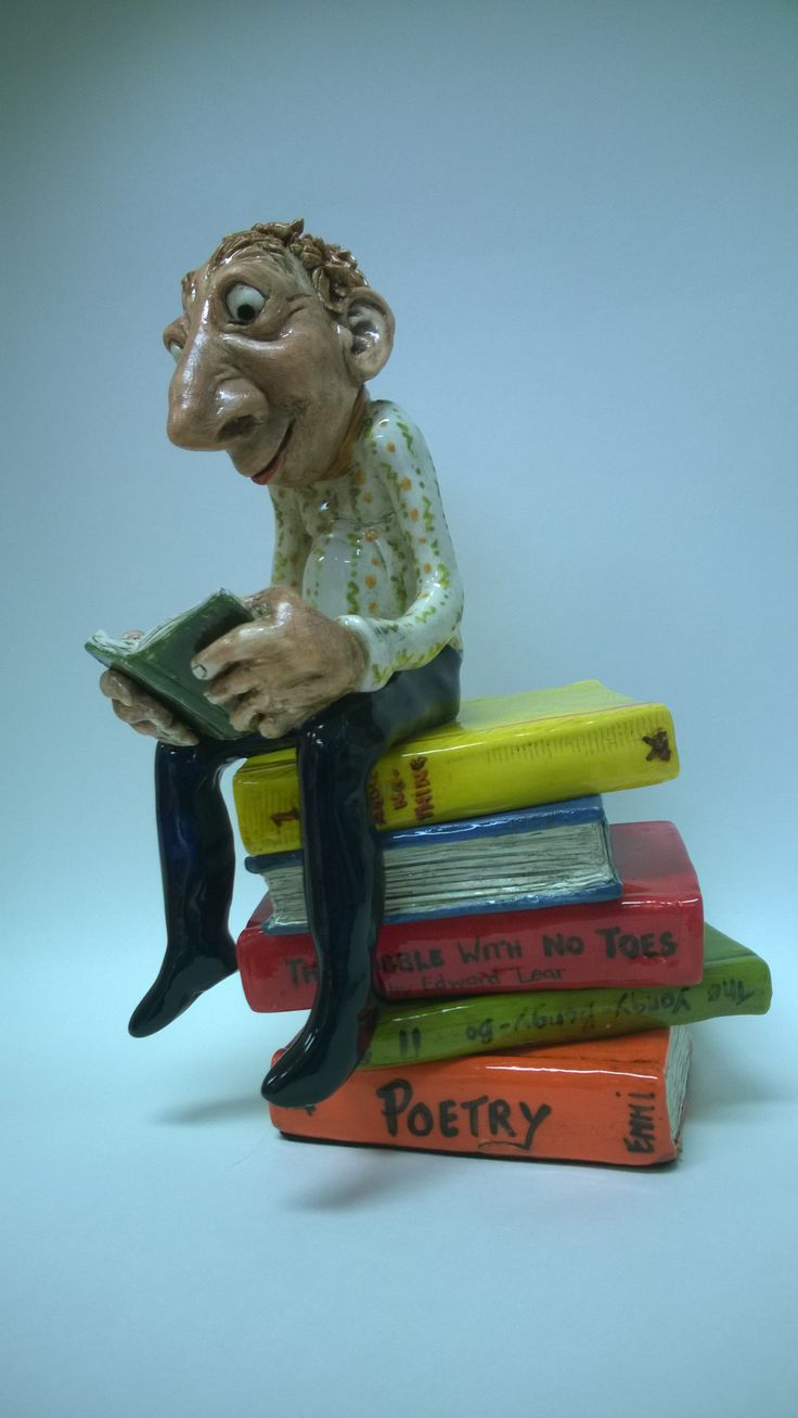 Pobble on a pile of books reading by Emmi