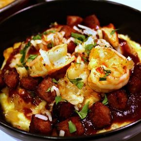 """Shrimp and Grits With Kielbasa   """"This is a traditional holiday dish for our family, but could be eaten as an entree, a side, or even breakfast anytime of the year!"""" #recipe #entertaining #holidays #mardigras"""