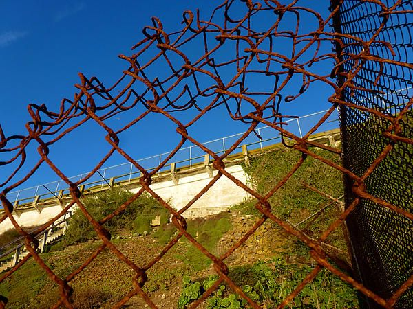 One of the exterior fences that has rusted away over the years. Taken on Alcatraz Island. Want this picture printed on canvas or cards etc? Click on the image :)