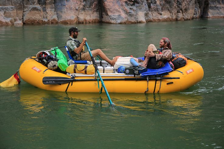 Blue SGX oars drift in the water; a spare pair of Cataract Oars are strapped to the side of the raft. These guys are in some deep conversation. #cataractpars #extremeoars #rafting www.cataractoars.com
