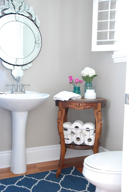 Powder Room.  cute furniture piece and cute idea for extra toilet paper.
