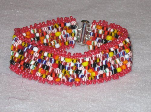 Isn't it GORGEOUS?  I just love the multitude of different color beads with all their different patterns on them.  The effect reminds me of the antique beaded Zulu necklaces that I have that are from