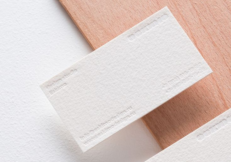Eskimo 2015 visual identity and blind embossed business card.