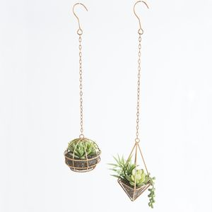 Create the ultimate contemporary décor with Aspire's hanging wire succulents. Brass chain adds a great industrial element, and the modern wire shapes contrast gorgeously with the imitation succulents. They look amazing in small spaces!