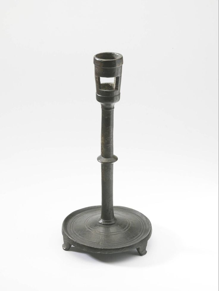 candlestick 1375-1400 Dimensions h. 15.5 cm Material and technique brass