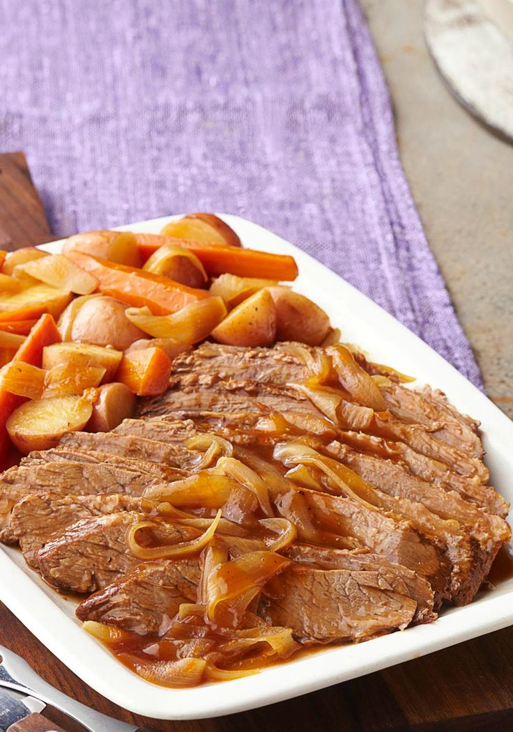 Slow-Cooker Barbecue Beef Brisket -- When it comes to barbecue beef brisket, slow and steady wins the race. This slow-cooker recipe is prepared with carrots, onions and red potatoes.