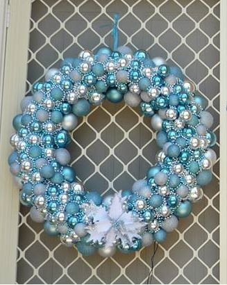 Home made xmas wreath using pool noodle, baubles, and bead garland. Made by Cellena