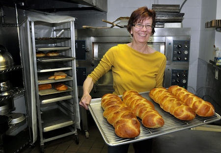 Kim Baker, owner of River and Rail Bakery, makes a variety of fresh breads daily at her shop at Heritage Station in Huntington.