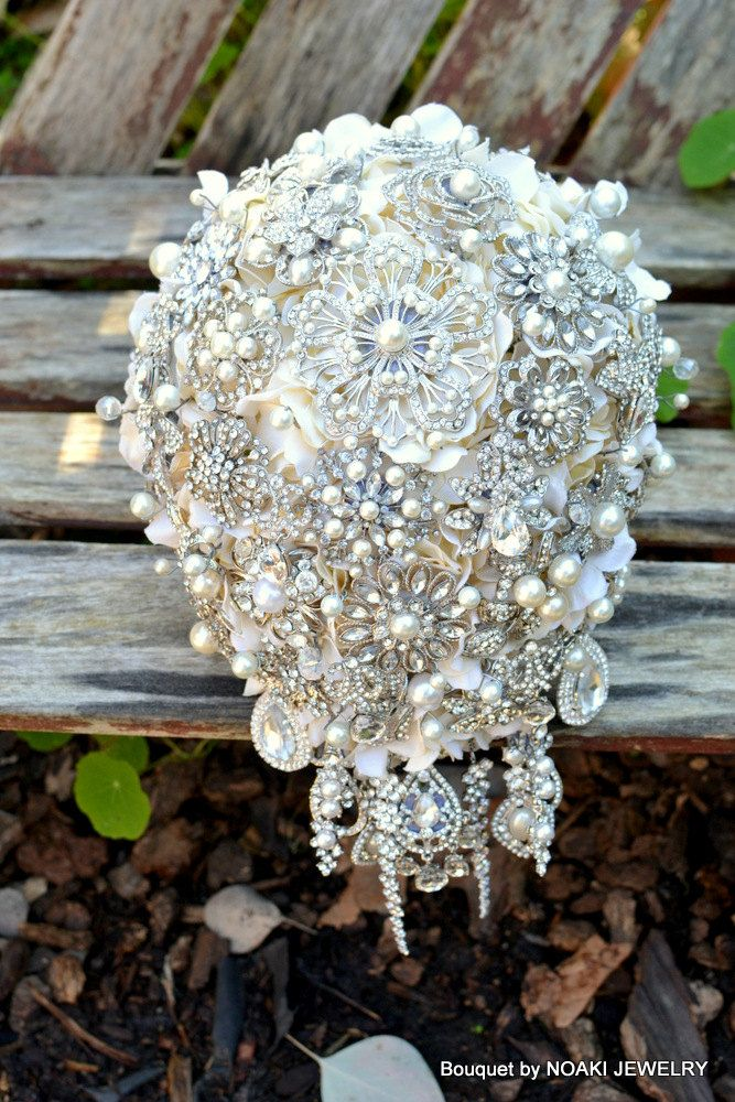 Rich pearl cascading brooch bouquet -- deposit on a made-to-order wedding bouquet. $275.00, via Etsy.