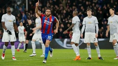 Andros Townsend celebrates after scoring against Manchester United.