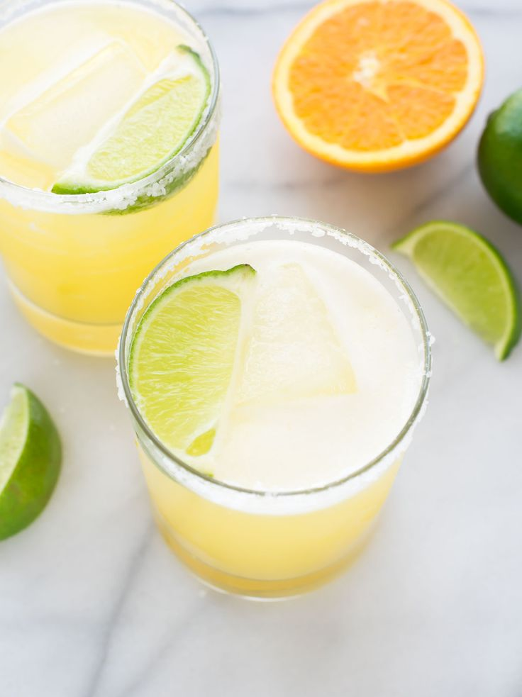 This skinny margarita recipe is incredibly light and refreshing for less calories! Made with just fresh lime juice, fresh orange juice, agave, and tequila.