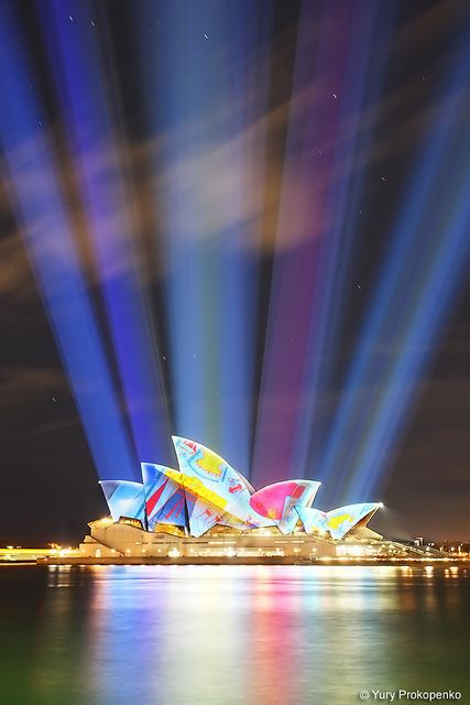 Vivid Sydney 2010    Those rays are actually horizontal and the light comes from projectors pointed to the Opera House from the overseas passenger terminal. But this is how it looks when you are directly underneath those projectors.