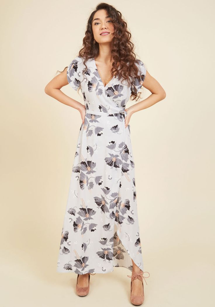 You'd be happy to explain how you fell in love with this light grey maxi dress, but you might be here awhile! Instead, let the tulip short sleeves, slate-and-pink blossom print, and wrap silhouette of this long, lightweight dress speak of your stylishness for themselves.