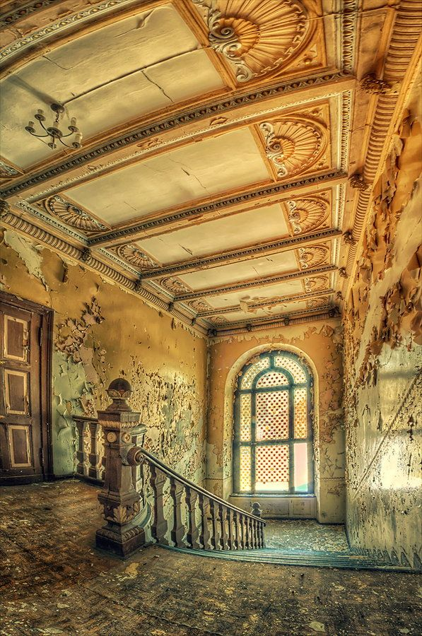 I love staircases that retain their magnificent beauty amid decay.  This is an abandoned palace in Poland.