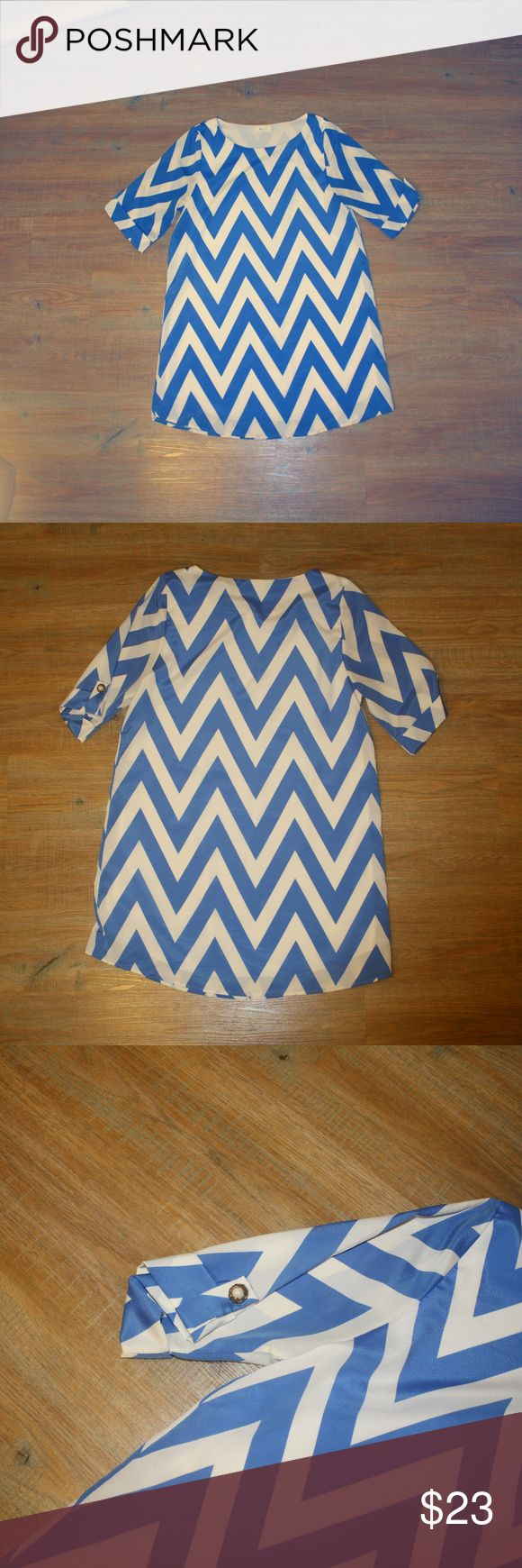Everly Blue Chevron Print Dress This dress has a beautiful blue chevron print and button detail on the sleeve. Perfect for casual occasion with flats or dressed up with heels! Very comfortable and perfect for summer weather. Everly Dresses Midi