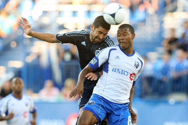 MONTREAL, CANADA - JULY 4: Paulo Nagamura #6 of the Sporting Kansas City and Patrice Bernier #8 of the Montreal Impact jump to head the ball during the MLS match at the Saputo Stadium on July 4, 2012 in Montreal, Quebec, Canada. (Photo by Richard Wolowicz/Getty Images)       Richard Wolowicz - Getty Images