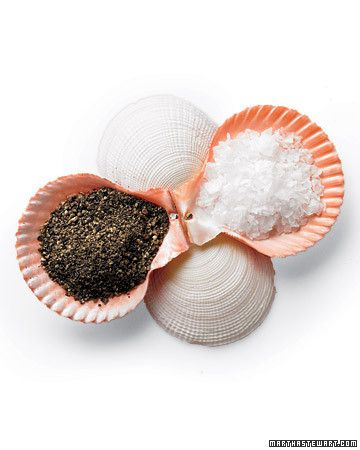 """A half shell was good enough for Botticelli's """"The Birth of Venus."""" Can humble condiments require more? Four clam or scallop shells make a summery set of salt-and-pepper dishes. First, run four shells per set through a dishwasher, secured in the silverware caddy. For the base, turn two shells top side up, and hot-glue them together at the hinge. Glue together the other two shells; then lay them face up and crosswise over the base, and glue."""