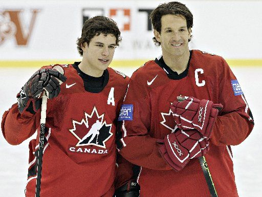 Brendan Shanahan (right) is a member of the Triple Gold Club as he won gold medals at the 1994 World Championships, 2002 Winter Olympics, and the Stanley Cup in 1997, 1998, and 2002 with the Detroit Red Wings.
