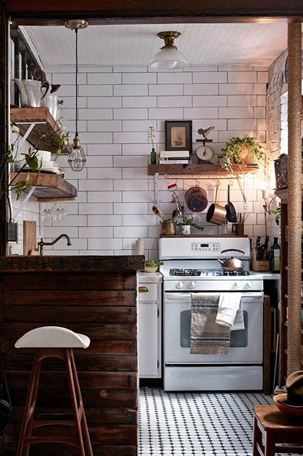 New York-based styling brand Zio & Sons designed this tiny space that combines white tile with natural wood for a rustic feeling.