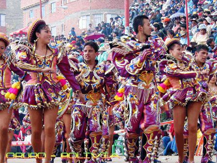 Caporales,  was created and presented to the public for the first time in 1969 by the Estrada Pacheco brothers, who were inspired in the Afro-Bolivian Saya character of the Caporal, a dance that belongs to the region of the Yungas, Bolivia. The dance, however, has a prominent religious roots.