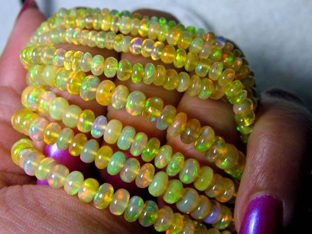 ETHIOPIAN WELO RONDELLE DRILLED  BEAD  2 STRAND 98.50 CTS  ethiopian  opal beads, opal beads, opal necklaces