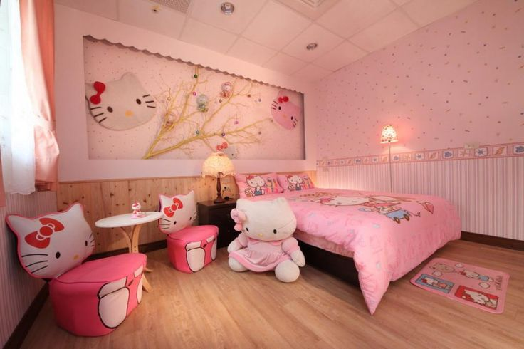 Fashionable bedroom interior design with hello kitty furniture set and wallpaper also pink bed cover and rug on laminate floor