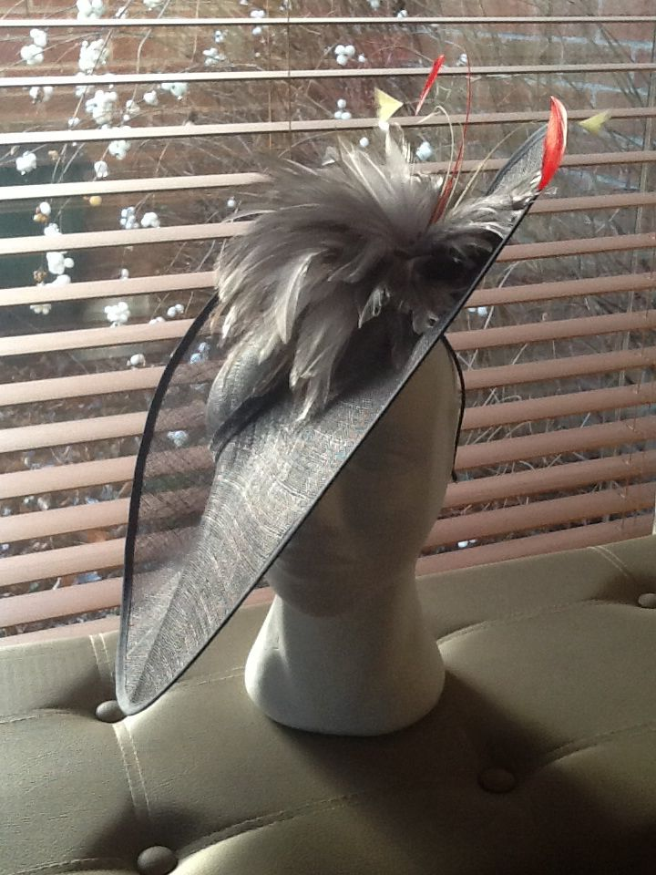 Saucer style hat made with gunmetal colour siminay and grey feather flower. By Nicky Gale.