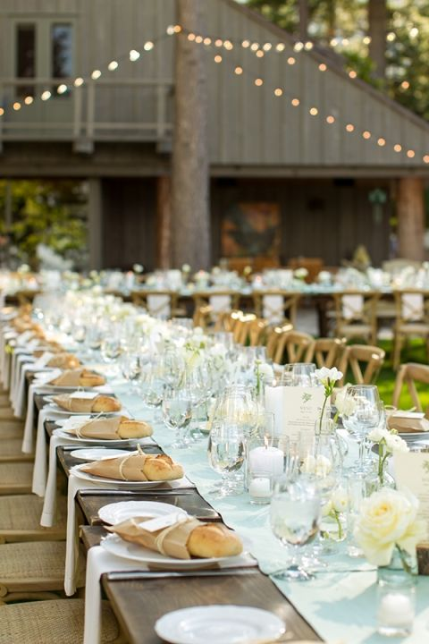 Mint and White Outdoor Reception Under Bistro Lights | MIke Larson Photography | Chic Lake Tahoe Wedding on the Beach