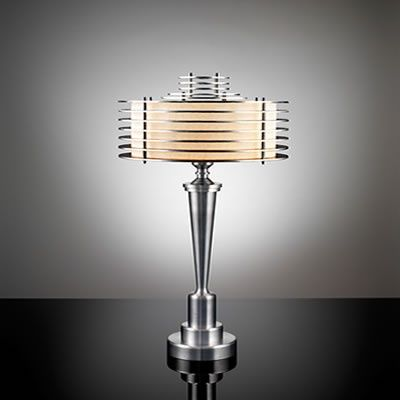 I have chosen this lamp because of its style. the fact that it has no lamp shade and it looks like glass instead adds to its different style than a normal lamp. the colors used really suit its style, also is an advantage to it because it can be put in many different colored rooms.