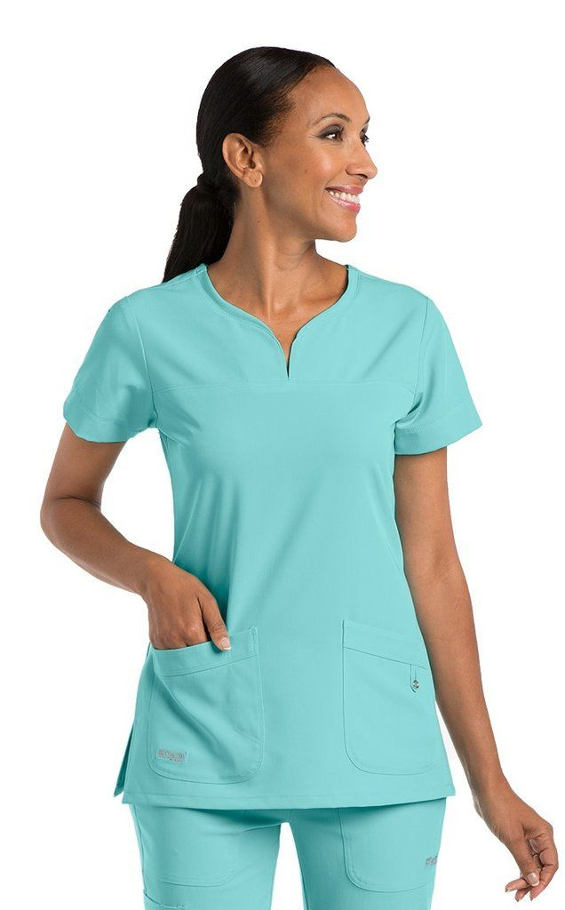 Grey's Anatomy Signature dentist scrub top is the perfect nurse scrub top and vet scrub top. THE MOST POPULAR SCRUB TOP ACROSS ALL OUR STYLES!!!!  Set distinction and experience luxury!  2 pocket notch neck Yoke and pocket detail Yoke back Ideal nursing uniform, dental uniform, medical uniform, beauty salon uniform and spa uniform.