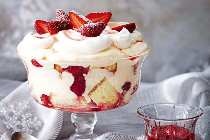 Peaks of whipped cream and sugar-dusted fruit sit atop spongy cubes drizzled with berry compote and mascarpone custard - yum.
