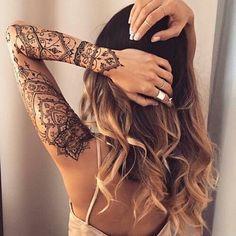 Feminine full sleeved arm tattoo.