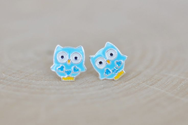 Super adorable Blue Owl Stud Earrings...decorated with tiny blue crystals * Owl measures 7mm * All components including butterfly backing are made with Sterling Silver 925 finished with enamel Thanks!