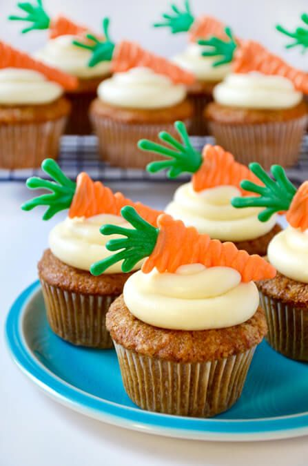 Kick up your dessert spread with a recipe for the best homemade carrot cupcakes topped with cream cheese frosting and edible carrot toppers.